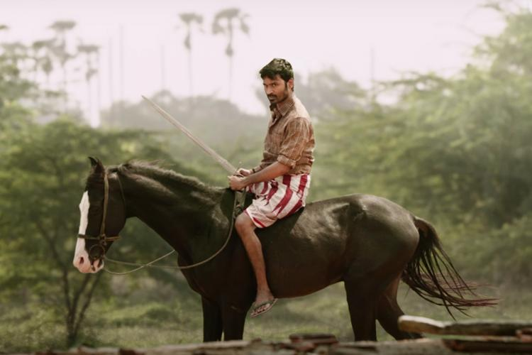 A screengrab with actor Dhanush sitting on a horse from movie Karnan teaser