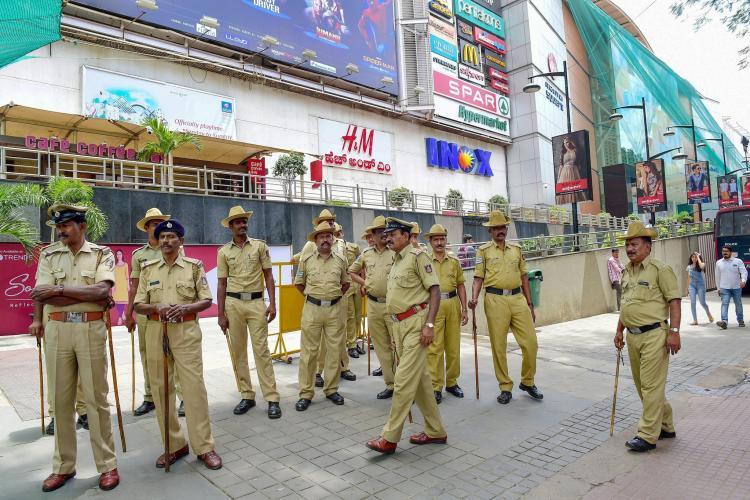 Karnataka Police standing outside a mall