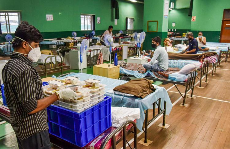 COVID-19 patients undergo treatment at a Covid Care Centre in Bengaluru