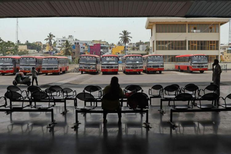 A passenger waiting at an empty bus stand in Bengaluru as bus strike continues