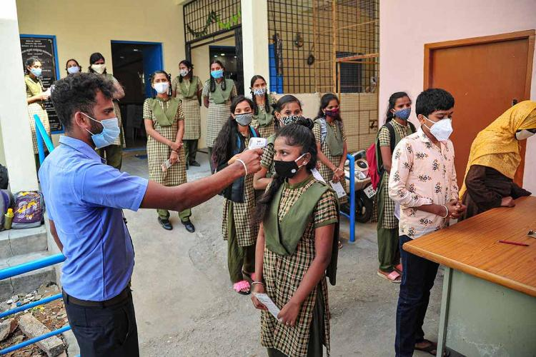 Students undergoing a temperature check during the coronavirus pandemic