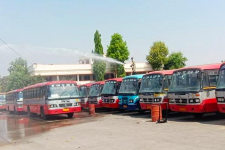 KSRTC Bus stand where workers are washing the buses