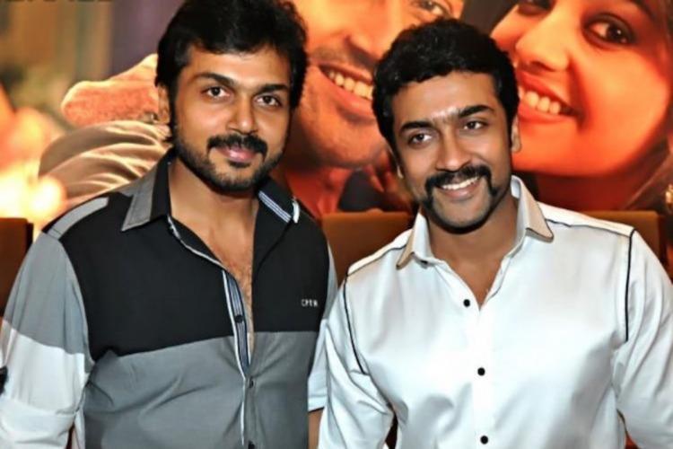 Actors Karthi and Suriya posing together for photo