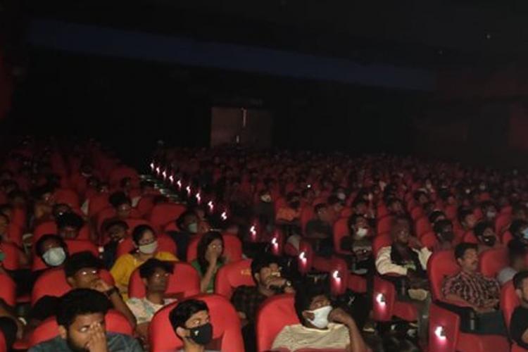 People inside Kasi theatre in Chennai
