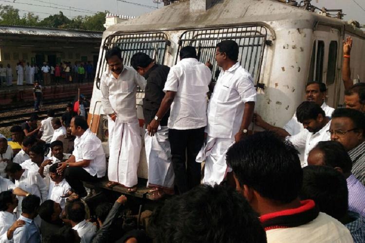 DMK holds rail roko for jallikattu Stalin leads protest at Mambalam Kanimozhi in Egmore