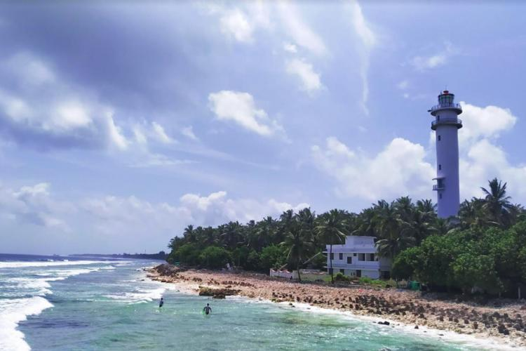 The Kavaratti Lighthouse in Lakshadweep on a claer day in front of the blue ocean