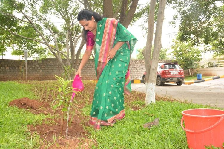 Haritha Haram TRS MP Kavitha plants saplings throws green challenge to 4 others