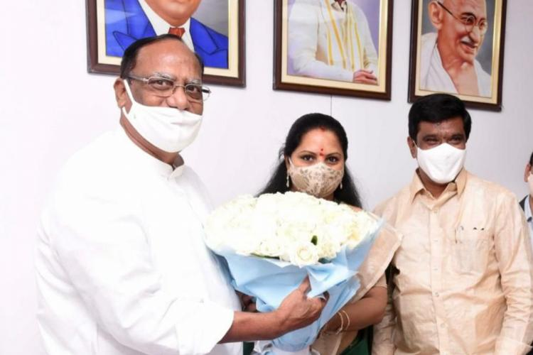 Kalvakuntla Kavitha swearing in as Nizamabad MLC accepting a bouquet from leaders