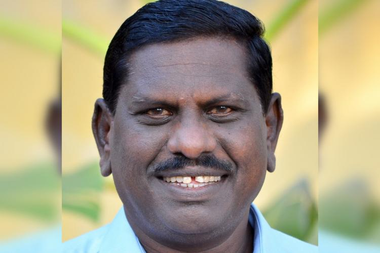 Kerala MLA Vijayadas is seen smiling in this image