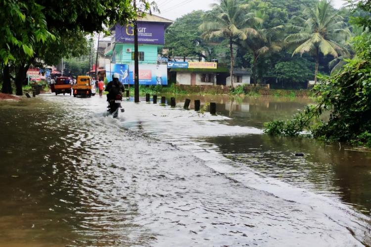 mild flooding on road in Kerala due to rains
