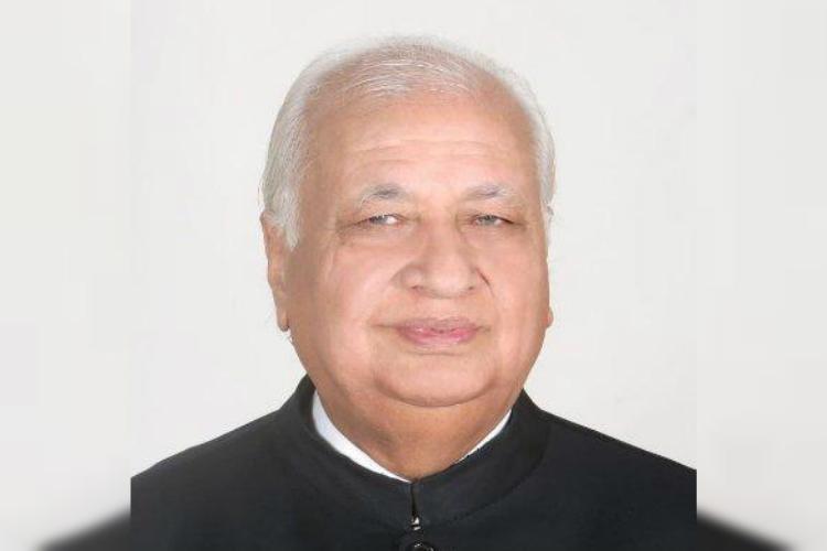 Kerala Governor Arif Mohammad Khan wearing a black overcoat