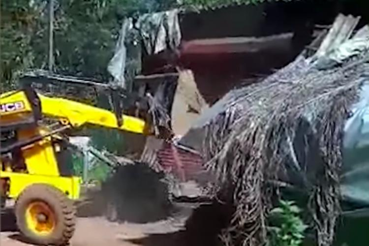Bulldozer tearing down a shop