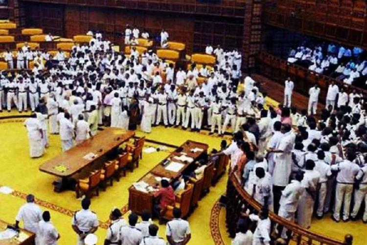 Opposition MLAs in Kerala assembly creating a ruckus in 2015