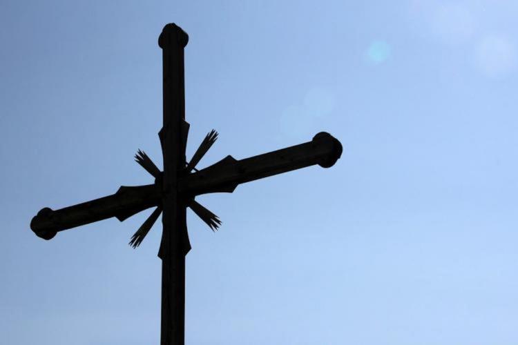 A Christian cross against a blue sky