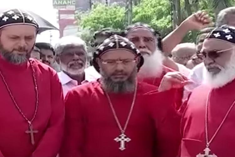 Kerala Jacobite Priests in red cassocks