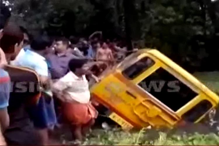 Two toddlers and their nanny die after school van falls into pond in Kochi