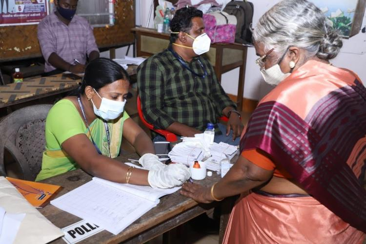 Aged woman casting vote in Nedumangad