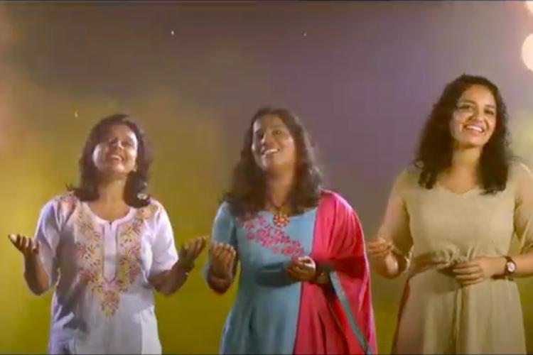 Three women playback singers singing