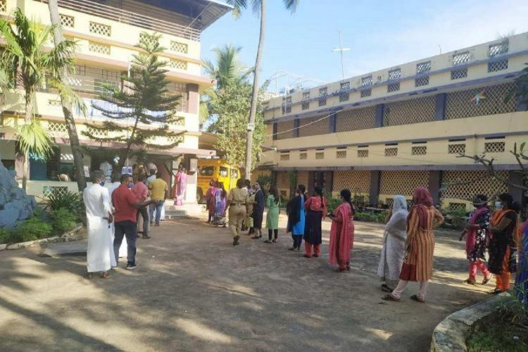 Voters queued up to cast their vote at a school