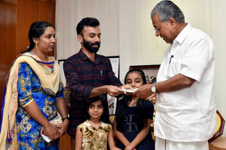 Kerala man donates Rs 1 lakh lottery winnings to CMs relief fund
