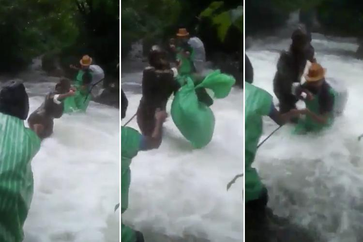 Watch How Kerala cops brave gushing waters to transport food supplies to others