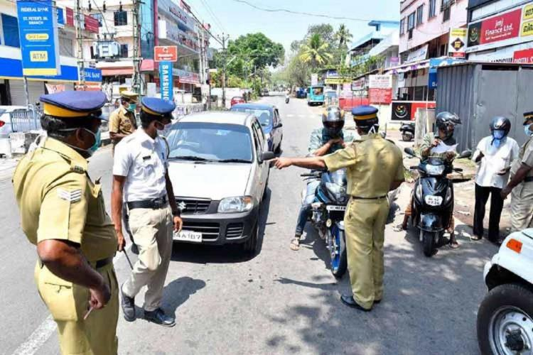 Kerala police check vehicles during lockdown in the state