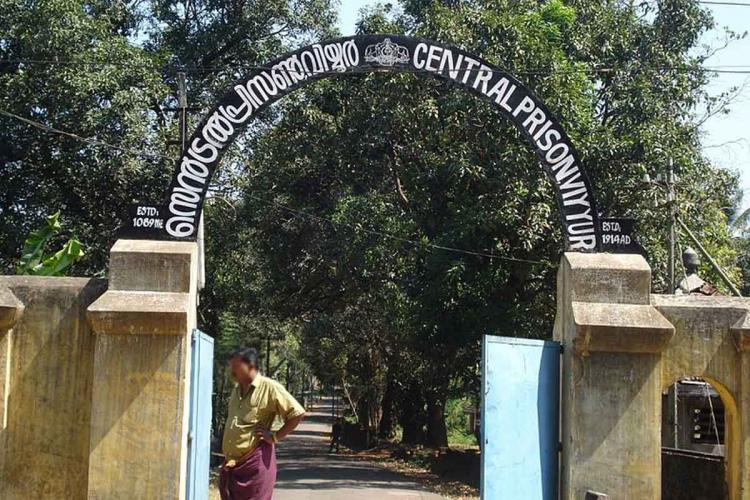Man standing in front of the entrance of Viyyur central prison in Kerala