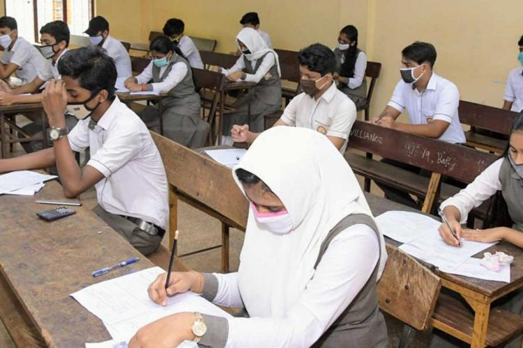 Students attending SSLC examination in Kerala during the pandemic time wearing masks and keeping physical distancing