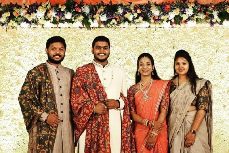 Couple and relatives wearing Khadi costumes for thier wedding in different coloured costumes with Kalamkari shawls