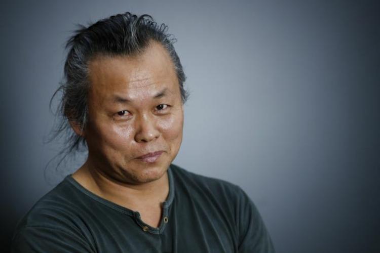 Close up shot of Korean filmmaker Kim Ki-duk in a green T shirt