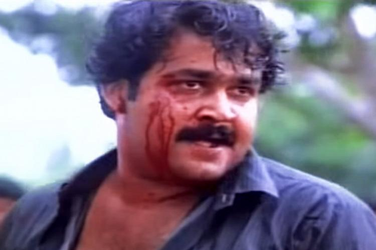 Mohanlal in Malayalam film Kireedam with blood running down his cheek and looking to the side