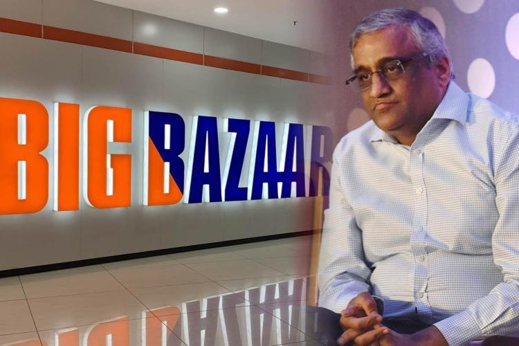 Kishore Biyani and the logo of Big Bazaar