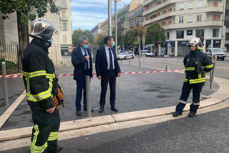 Nice Mayor Christian Estrosi and other French police officials seen at the spot where the deadly knife attack that killed three was reported
