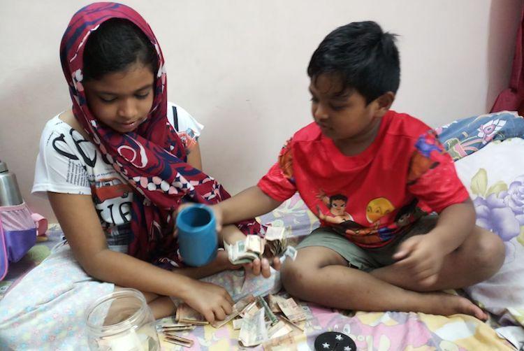 Small hands big hearts Kerala siblings break piggybank for flood relief