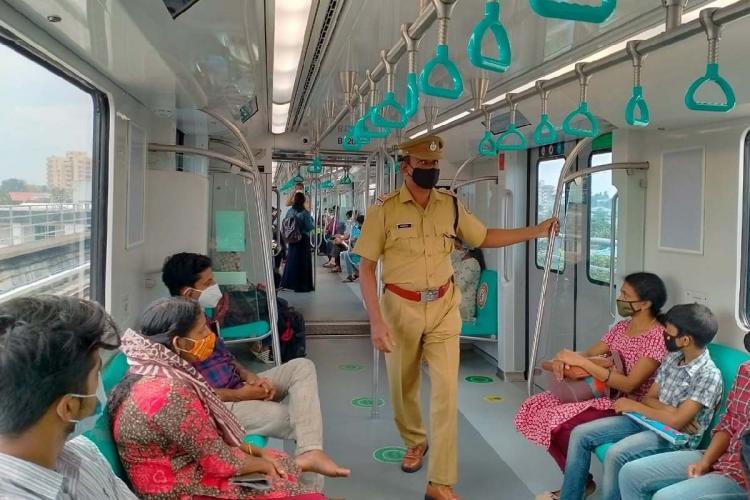 Passengers inside Kochi metro train