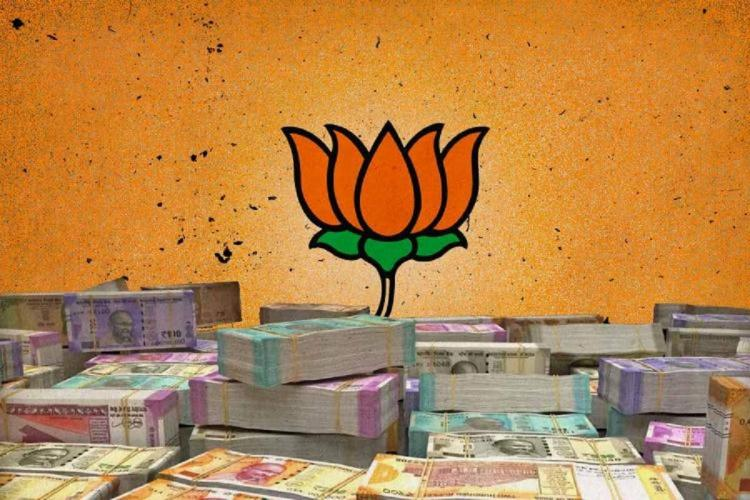 Animated image of a lotus in a saffron background standing on top of bulks of currency notes