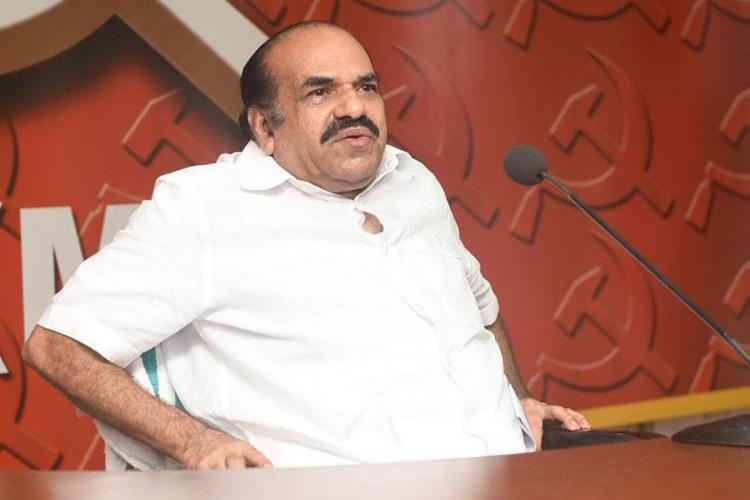 Kodiyeri Balakrishnan wearing a white shirt sitting on a chair during a press meet