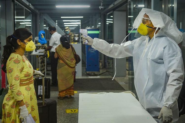 Passenger being screened for temperature at airport amid coronavirus