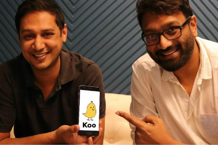 Koos cofounders holding up app screen with logo