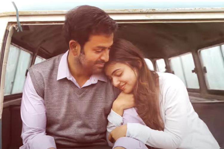 Prithviraj and Nazriya as Joshua and Jenny from the film Koode with Prithviraj wearing a grey sweater and Nazriya dressed in white