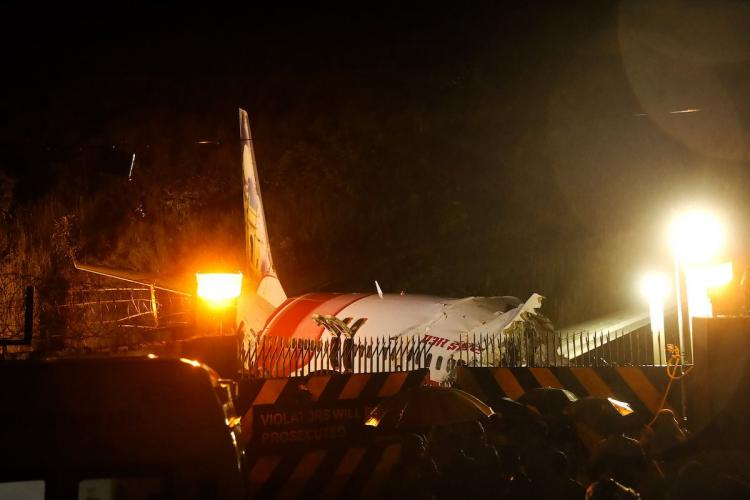 Mangled remains of an Air India Express flight en route from Dubai after it skidded off the runway while landing, at Karipur in Kozhikode
