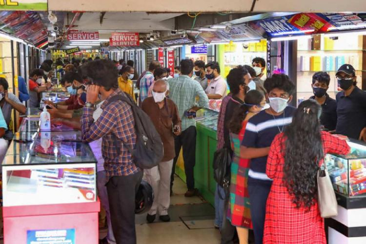 People at a mobile shop in Kerala's Kozhikode
