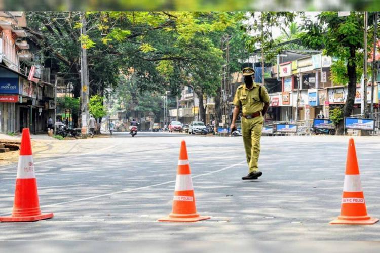Police officer on a deserted road