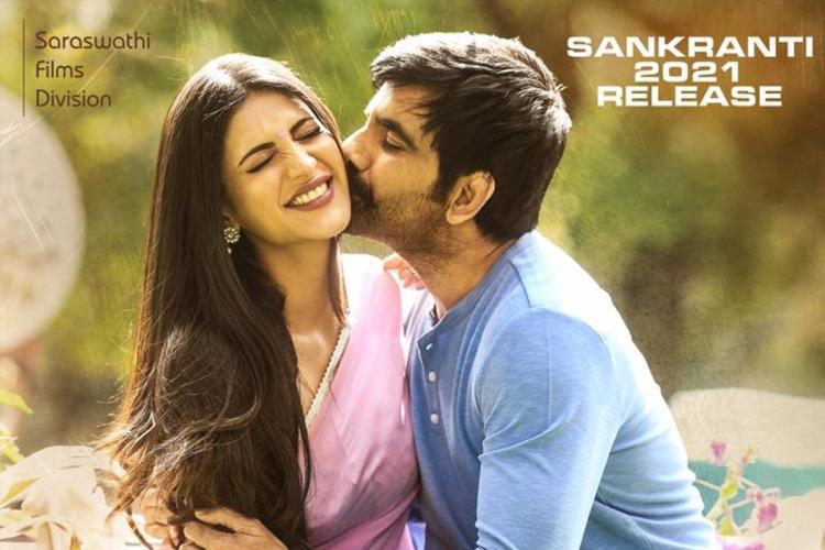 Shruti Haasan in a pink sari with Ravi Teja in a blue shirt holding her on the poster of Telugu film Krack