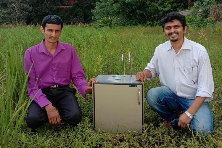 Dr Vishnu Prasada Bhat co-founder and CTO and Sandeep Kondaji founder and CEO kneeling in a green field with the soil testing device in between them