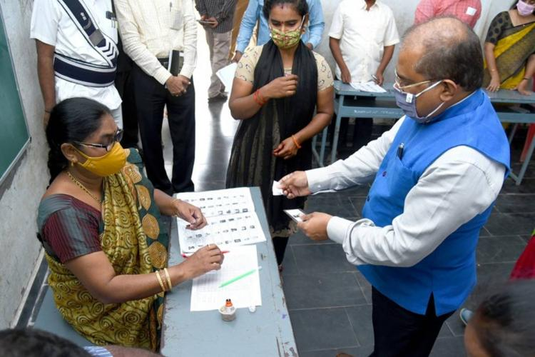 Krishna District Collector Md Imtiaz examining a polling station during fourth phase of panchayat polls