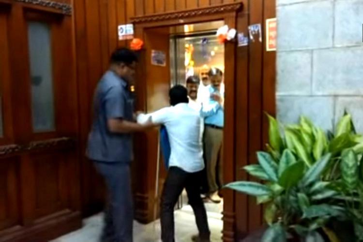 Watch Karnataka ministers bodyguard manhandles visually impaired man