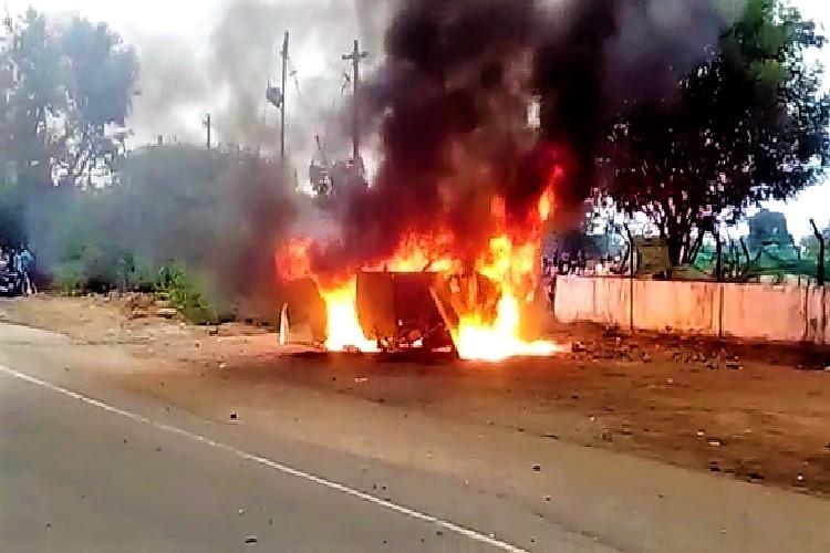 Mob sets media van on fire after cops leak story of SI trying to rape woman before suicide