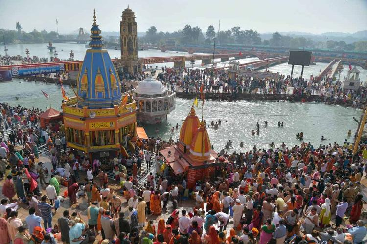 Devotees gather at Har Ki Pauri ghat in Haridwar to offers prayers during Kumbh Mela 2021 amid surge in Covid-19 cases across country