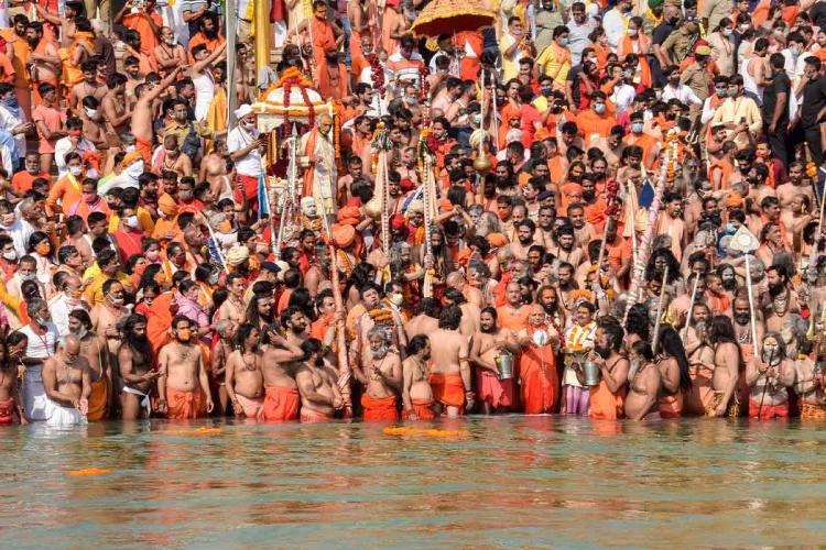 The large crowd gathered at the Kumbh Mela to take a dip in the Ganga